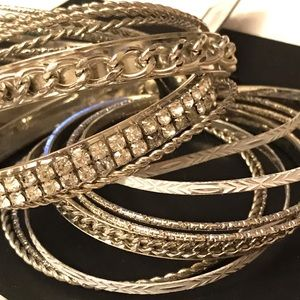 Large stack of bangle bracelets